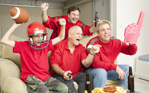group of men wearing red watching football game